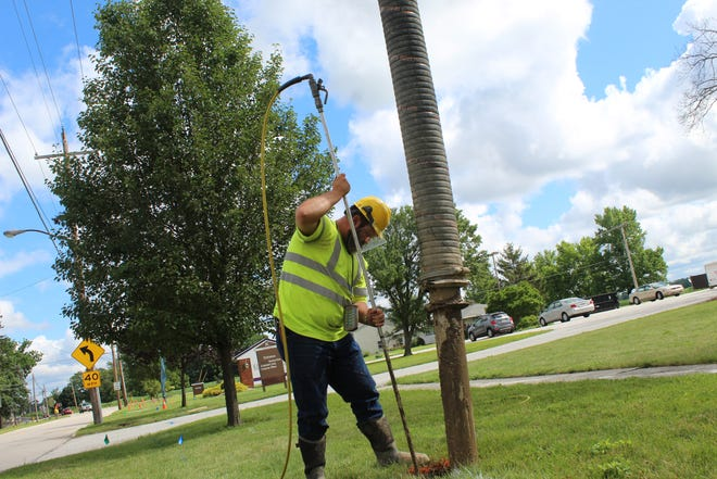 Brad Brininger, a foreman/operator with Kenneth Myers Construction Co. in Green Springs, works with the company's vacuum truck to help workers spot existing underground lines before installing fiber optic cable lines along Ohio 19 in the village.