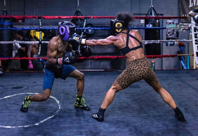 Alycia Baumgardner, right, is set to return to the ring after a 19-month layoff due to the COVID-19 pandemic and knee surgery.