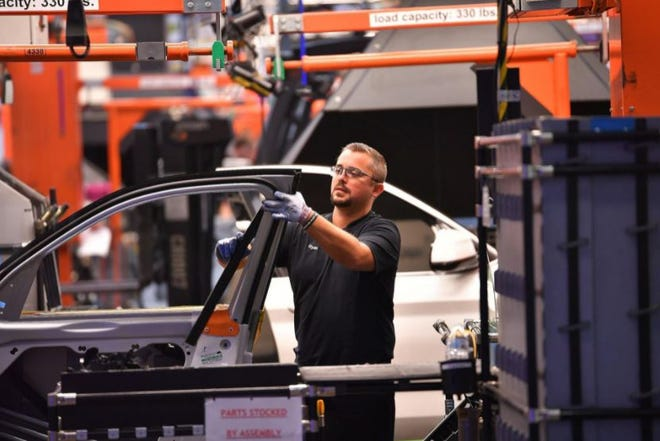 A BMW employee works on a car in this September 2019 file photo at the Spartanburg County plant.