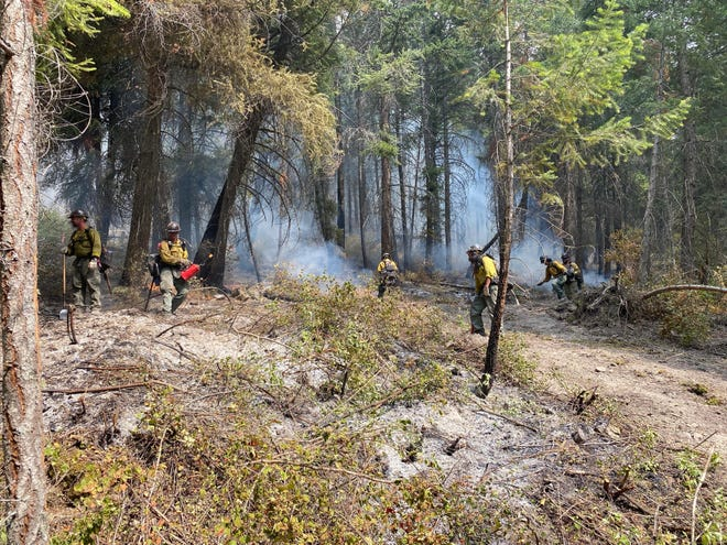 Firefighters working on the edge of the Boulder 2700 Fire
