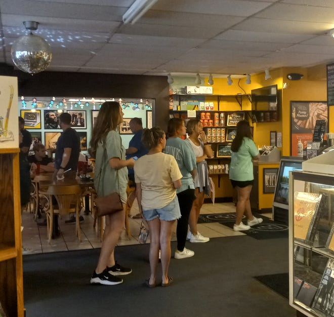 Customers wait in line at  T-Bone's Records & Cafe in Hattiesburg, Miss., on Monday, Aug. 2, 2021.