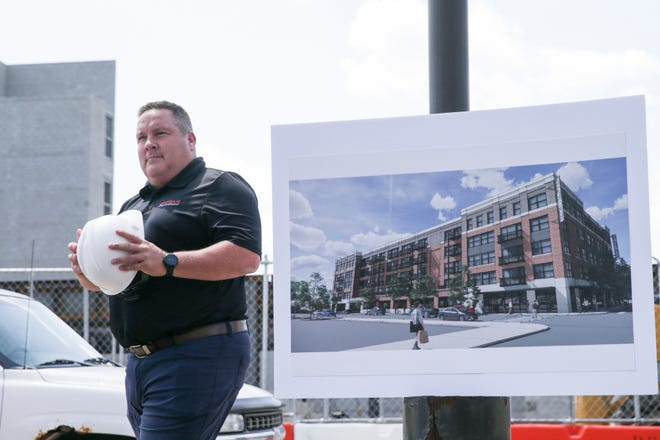 """Shelby Bowen, President at Rebar Development, walks away from the microphone at a construction """"kick-off"""" event for The Ellsworth, 515 South Street, Tuesday, Aug. 3, 2021 in Lafayette."""