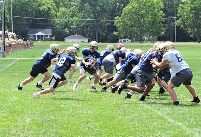The Lancaster football team began practice Monday morning with the start of two-a-days as the Golden Gales prepare for the season opener on Aug. 20 at home against Pickerington North.