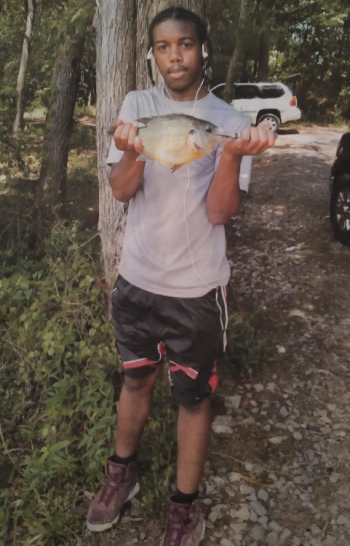 Lamaurie Gathings, 17, pictured during a 2020 fishing trip with his father, was shot and killed on June 4, 2021.