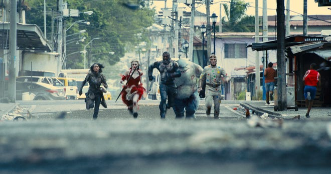 "Squad goals: Ratcatcher 2 (Daniela Melchior, from left), Harley Quinn (Margot Robbie), Bloodsport (Idris Elba), King Shark and Polka-Dot Man (David Dastmalchian) head into action in ""The Suicide Squad."""