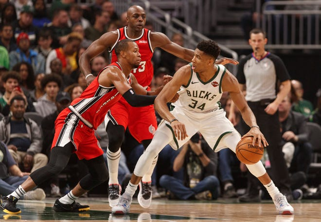 Rodney Hood, shown guarding the Bucks' Giannis Antetokounmpo in 2019, is joining Milwaukee on a one-year deal.