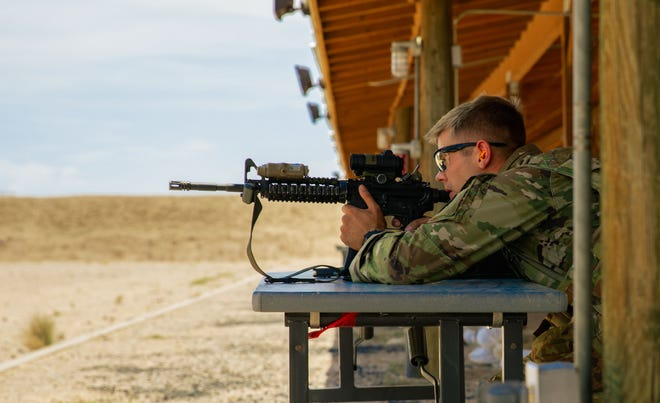 Sgt. William Lukens of the Tennessee Army National Guard, takes aim at his target during the Three Weapons Challenge at the 2021 Army National Guard Best Warrior Competition at Florence Training Site, Arizona, July 20, 2021. The three-day competition consists of physically and mentally demanding tasks.