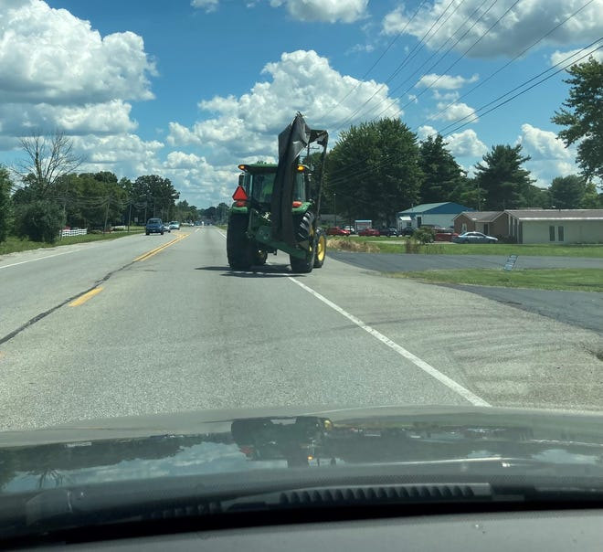 A tractor makes its way down Broad Street in Pataskala on Aug. 2.