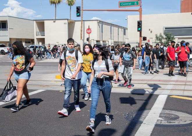 Students leave after their first day at Central High School in Phoenix on August 2, 2021.