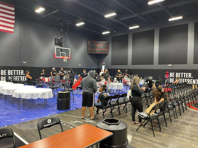 Aug 1, 2021: PHH Prep boys basketball team have local elementary through high school students get free haircuts, backpacks and other school supplies for a back-to-school giveaway at The PHHacility basketball complex in Phoenix, Ariz.