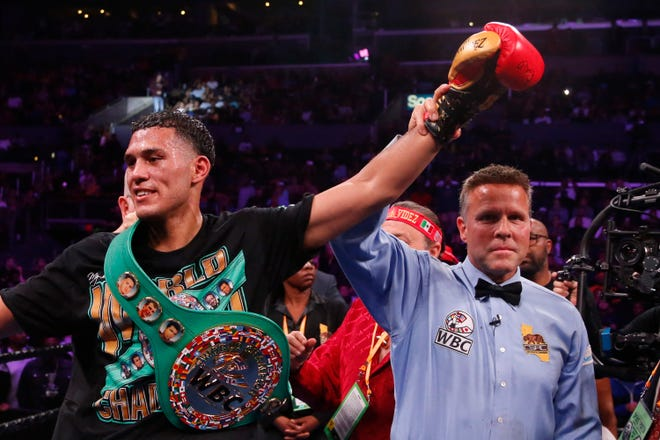 David Benavidez celebrates after defeating Anthony Dirrell during the WBC World Super Middleweight Championship boxing match Saturday, Sept. 28, 2019, in Los Angeles. (AP Photo/Ringo H.W. Chiu)