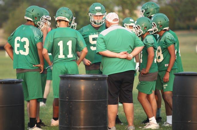 Eldorado High School players listen to head coach Jon Long at football practice Tuesday, Aug. 3, 2021, in Eldorado.
