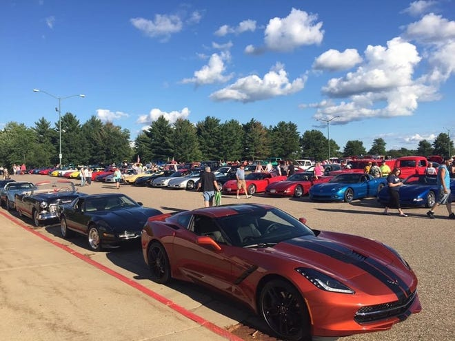 Passersby check out cars that participated in the Corvettes of the North car cruise.