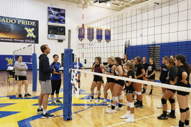 University of Toledo assistant volleyball coach Evan Antal talks to the West Muskingum High School volleyball team during a training session on Tuesday.