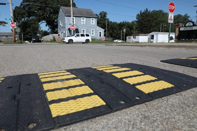 Traffic on Pine Street passes speed humps on Fess Street in Zanesville on Tuesday. The city is considering dozens of additional locations for the humps.
