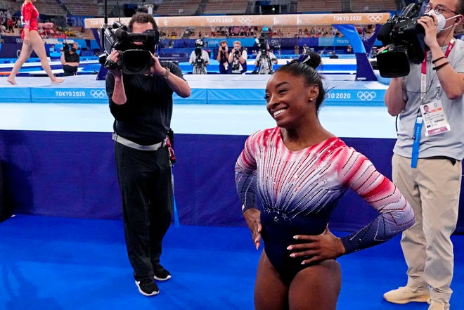 Simone Biles smiles after competing on the balance beam.