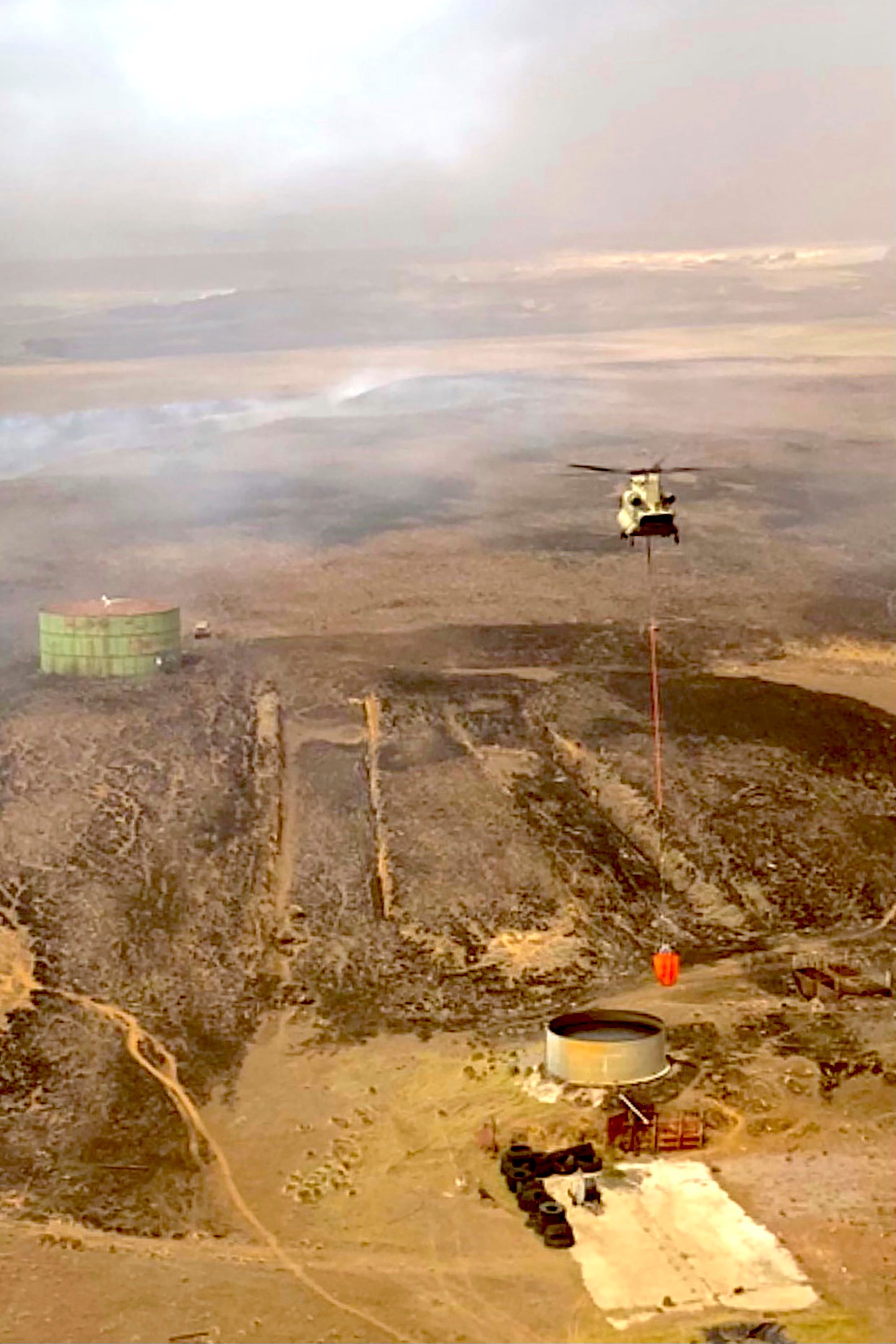 Strong winds threaten to whip up  biggest ever  wildfire on Hawaii s Big Island; California blaze grows as temperatures rise