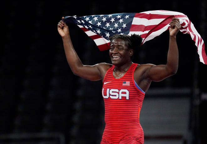 Tamyra Mensah-Stock celebrates after defeating Blessing Oborududu in the women's freestyle 68kg final.