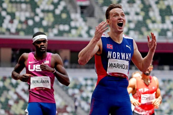 Karsten Warholm (NOR) celebrates winning the gold medal men's 400m hurdles final during the Tokyo 2020 Olympic Summer Games at Olympic Stadium.