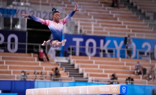 Simone Biles competes on the balance beam.