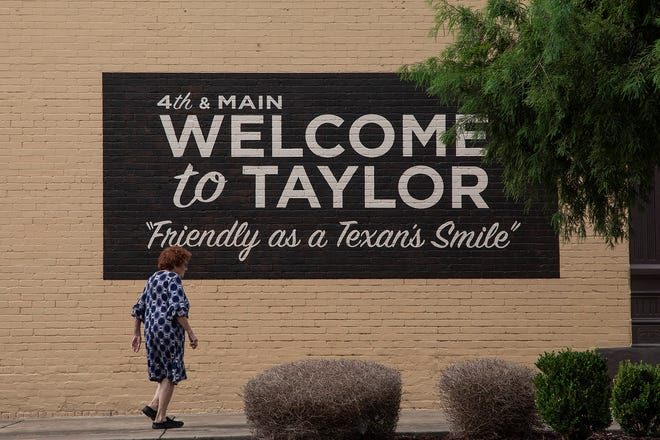 A mural in downtown Taylor touts the small town's charms. Samsung has said it's considering Taylor as a site for a planned $17 billion computer chip factory.