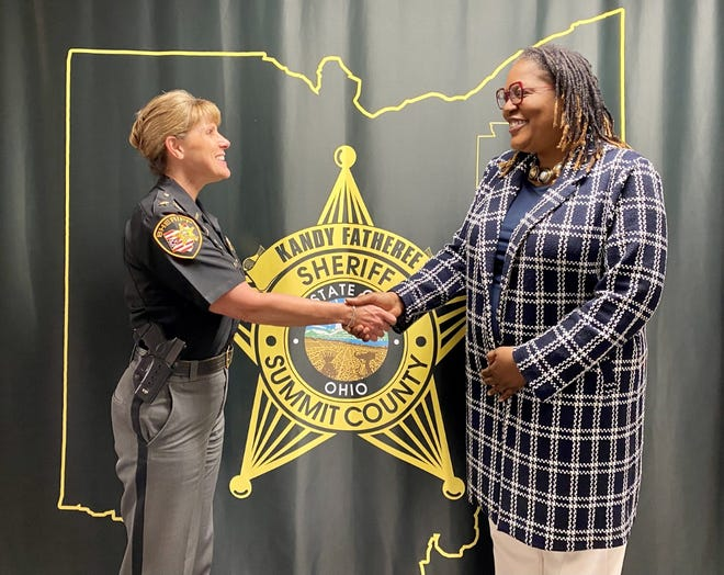Sheriff Kandy Fatheree (left) shakes hands with Esther Thomas, the sheriff office's new DEI Director.