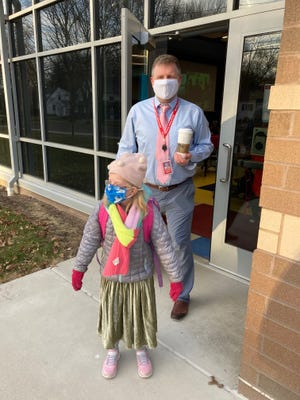 Lyra stands in March with Case Elementary Principal Matt Doslak.