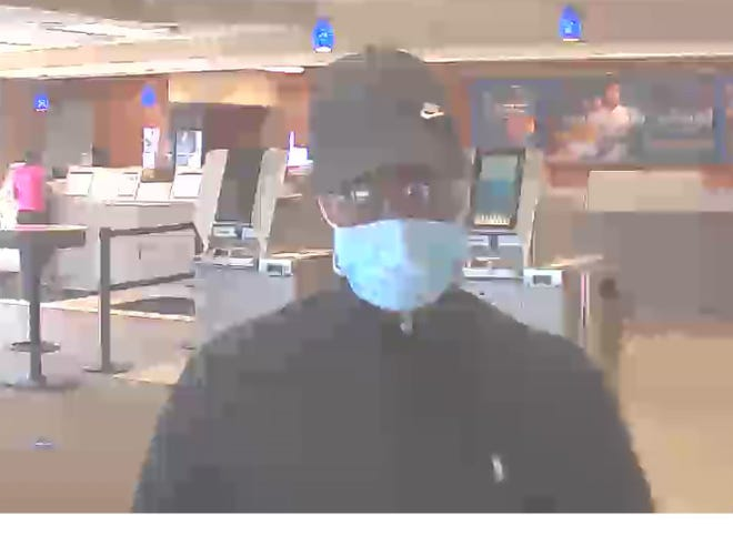 Akron police released photos of a person who's accused of robbing a bank in Akron.
