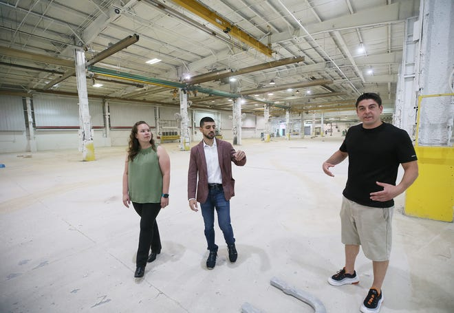Ellen Stouffer, HR manager and Ash Abbas, president and Fred Guerra, co-owner of Jetpack, tour the renovations at the former Waltco building on Monday Aug. 2, 2021. The company's  Akron-based vitamin/nutrient fulfillment distribution center is moving to Tallmadge facility.