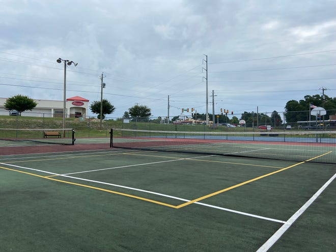 The new yellow lines on the tennis court at Goodale Park in Grovetown are for pickleball – a sport rising in popularity across the area.