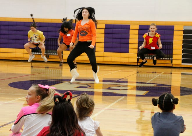 Four members of the Early High School dance team, Early Belles, go airborne as they perform a routine at the mini-Belles camp Wednesday. The three-day camp, for girls in grades K-5, is being held in the Early Middle School gym and ends Thursday. The four Belles pictured are (from left) sophomore Trista Burleson, junior Yasmin Ibarra, senior and co-captain Olivia Kuykendall and freshman India Vogt.