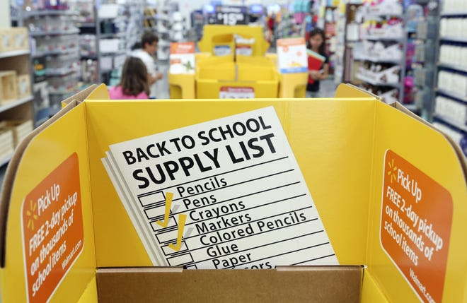 Shoppers are greeted by signage promoting back-to-school shopping at Wal-Mart on Sawmill Road. Ohio will hold its annual sales tax holiday Aug. 6-8, 2021. [Eric Albrecht/Dispatch]