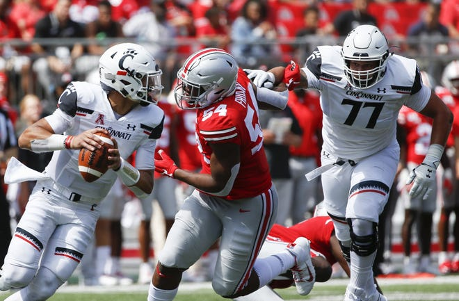 Ohio State Buckeyes defensive end Tyler Friday (54) tries to break free of Cincinnati Bearcats offensive lineman Vincent McConnell in a 2019 game at Ohio Stadium. Friday will miss most of the upcoming season because of an injury, coach Ryan Day said Wednesday.
