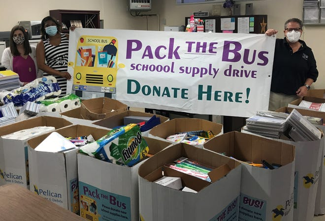 Volunteers display some of items that will be distributed to needy families in Terrebonne and Lafourche through the annual Pack The Bus School Supply Drive.