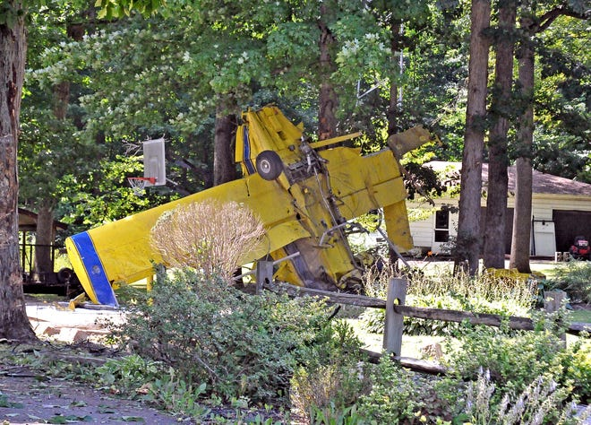 This crop duster landed nose up in a driveway on Bechtel Road east of Wooster Wednesday. The pilot managed to walk away from the crash and was transported to a hospital for evaluation.