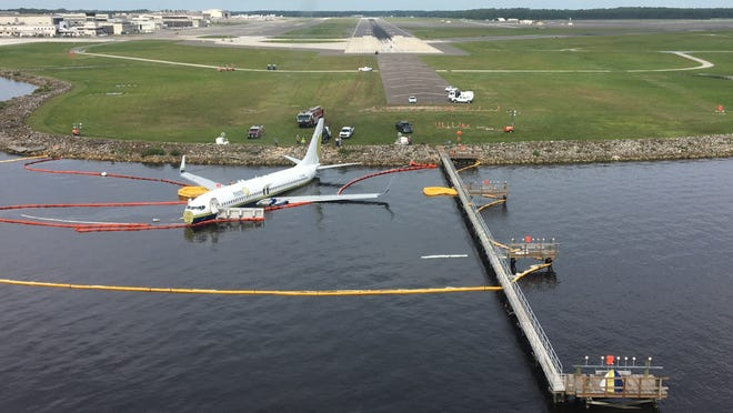 Miami Air flight 293 sits  in the shallow water of the St. Johns River on May 4, 2019, the day after it slid off a rain-soaked runway while landing in a rainstorm at Naval Air Station Jacksonville