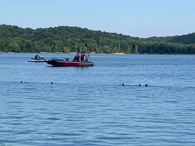 Rescuers search Tuesday for a drowning victim near Fairfax Beach at Lake Monroe.