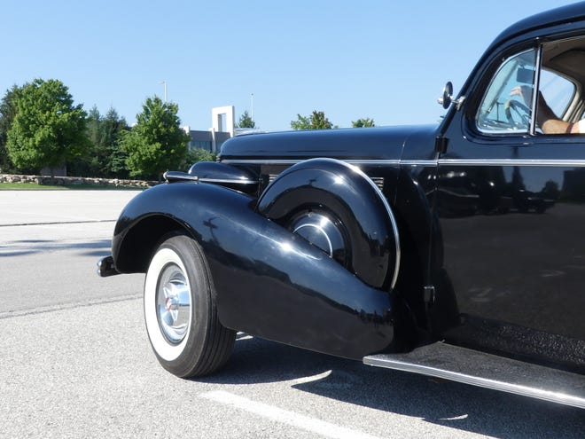 A 1937 Buick Roadmaster seen for just a moment before it drove off Wednesday morning.