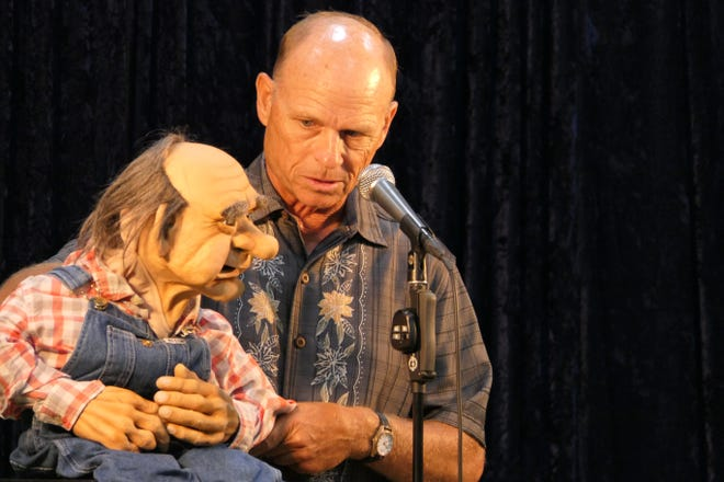 Ventriloquist Greg Claassen speaks with his dummy Harley McCoy during the Reno County Farm Bureau's 100th anniversary dinner.