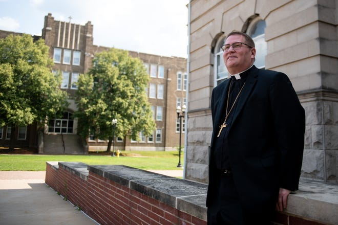 Bishop Louis Tylka poses for a photograph outside the Catholic Diocese of Peoria Spalding Pastoral Center on Wednesday, August 4, 2021.  Tylka moved to Peoria from Chicago for the position about a year ago.