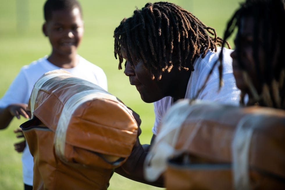 """Jaquarius """"Big Baby"""" Green participates in a drill during the 309 Punishers practice at Manual High School this week."""