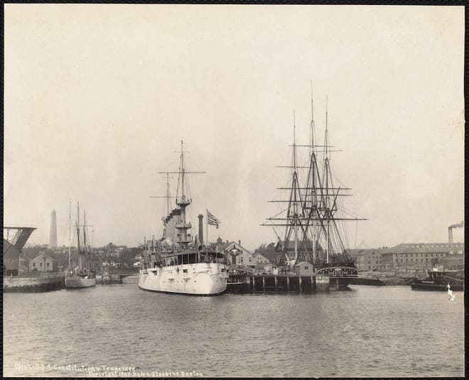 Here are the U.S.S. Constitution and Tennessee at Charlestown Navy Yard on Sept. 17, 1907. The Constitution is on the right side. The Bunker Hill Monument is on the left in the background.