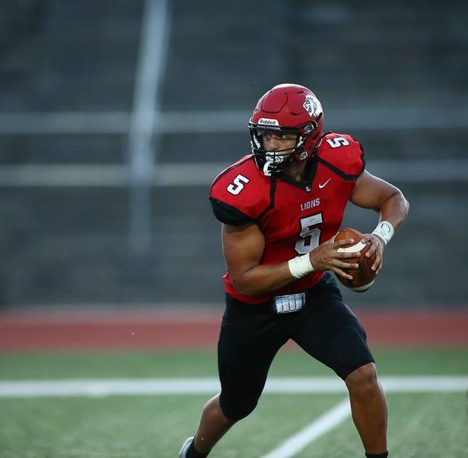 Shown is Lansing senior quarterback Caden Crawford.
