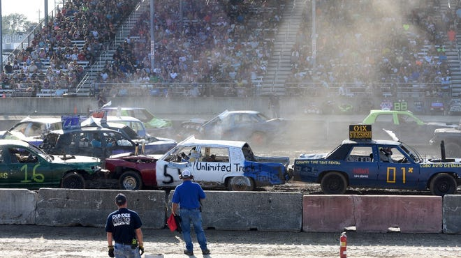 Cars smash each other during the 6 p.m. show of the Monroe County Fair Demolition Derby Tuesday night.
