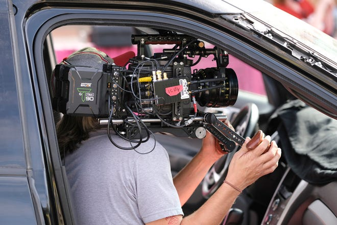 """A cameraman works on the set of the Oklahoma film """"Out of Exile"""" at the Flamingo Apartments on NW 23 in Oklahoma City Thursday, October 15, 2020."""