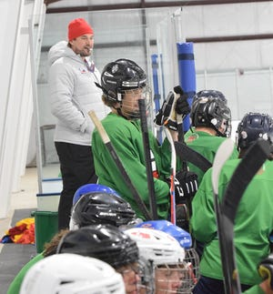 Fedor Fedorov (left) looks over a scrimmage during the Fedorov Elite Hockey Academy last week at the Petoskey Ice Arena.