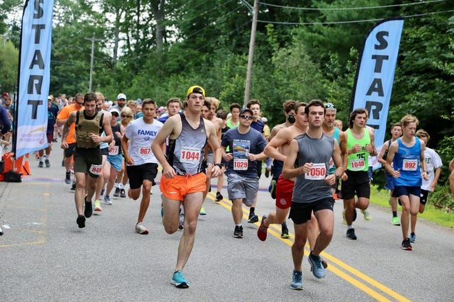 Eli Nixon (1044) and Jay Whitesell (1050) both of Eliot, Maine, get out to a quick start at Sunday's annual York Days 5K in York, Maine.
