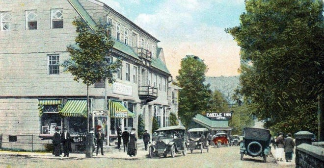 A vintage postcard featuring Delaware Water Gap's Main Street.