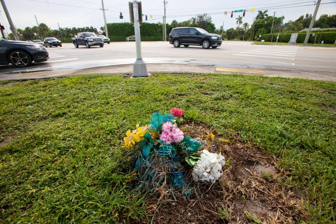 Flowers left from a fatality at the intersection of La Chalet Boulevard and Military Trail mark the intersection Tuesday, August 3, 2021 where two people were killed and two others were critically injured in a crash near Boynton Beach Saturday evening.