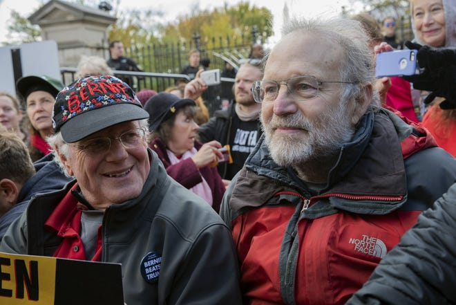 FILE - In this Nov. 8, 2019 file photo, Ben Cohen, left, and Jerry Greenfield, co-founders of Ben & Jerry's ice cream, attend a protest in Washington. The Vermont-based Ben & Jerry's has always been known for promoting social causes as much as its flavors of ice cream, but few have attracted as much attention as its decision to stop selling its ice cream in the Israeli-occupied West Bank and contested east Jerusalem.